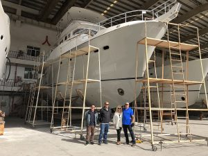 Salesman Eric Leishman and Project Manager Mike Jensen inspect progress of Nordhavn 60#80